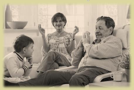 Sepia grandfather telling grandson stories